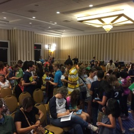 Spellers collecting autographs in their Bee Keepers during orientation.