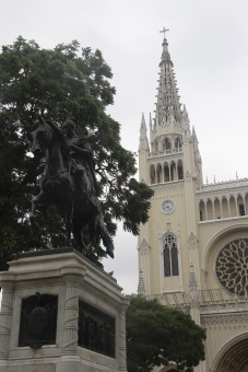 Monument of Simon Bolivar with the beautiful Metropolitan Church of Guayaquil in the background.
